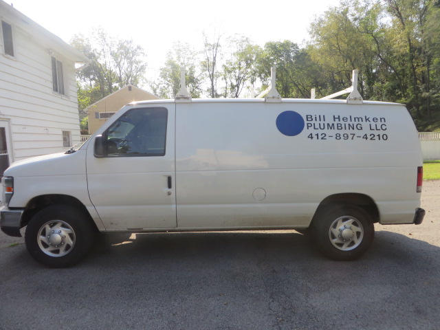 Bill Helmken Plumbing LLC work van with phone number 412-897-4210
